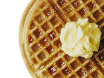 Traditional classic belgium american waffle with butter and maple syrup. Close up of traditional classic belgium american waffle with butter and maple syrup royalty free stock photos