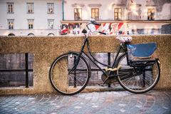 Traditional classic bicycle near water canal Stock Images