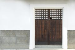 Traditional classic Japanese wood door or gate and stone wall in. Ancient japanese house, japan royalty free stock photography