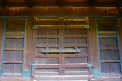 Traditional classic Japanese wood door, old wooden gate. Japanese style royalty free stock photo