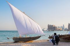 Traditional classical style boat at the coast of Katara cultural village. stock images