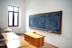 Traditional classroom interior with blackboard Royalty Free Stock Images