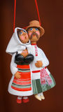 Traditional clay couple. Clay man and woman toys in national costumes Royalty Free Stock Image