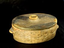 Traditional clay pot with the lid Stock Photo