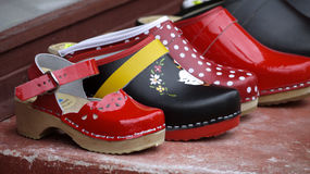 Traditional clogs in meny color. Stock Images