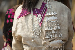 Traditional clothes and silver jewelery of Muser hill tribe.  royalty free stock photography
