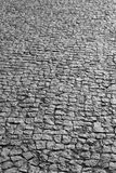 Traditional cobblestone floor street detail in black and white Royalty Free Stock Photography