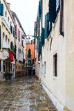 Traditional cobblestone street and colorful buildings in Venice, Italy royalty free stock photo