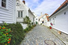 Traditional cobblestone street with wooden houses in the old town of Stavanger, Norway Royalty Free Stock Image