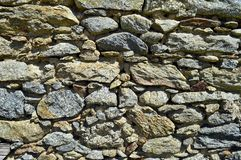 Traditional cobblestone wall. Of an old abandoned house, Greece Royalty Free Stock Images