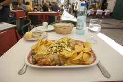 Traditional codfish dish in Portugal. 1 June 2015. Lisbon, Portugal. Traditional codfish dish called Bacalhau au Narcisa in Lisbon, Portugal Stock Images