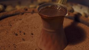 Traditional coffee on the sand. close-up. Traditional coffee on the sand stock video footage