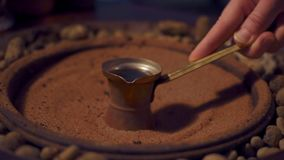 Traditional coffee on the sand. close-up. Traditional coffee on the sand stock footage