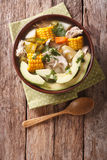 Traditional Colombian ajiaco soup close up in a bowl. Vertical t Stock Photo