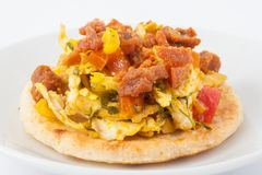 Colombian arepa topped with chicken breast and pork Stock Images