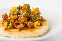Colombian arepa topped with ground beef Royalty Free Stock Photography