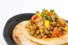 Colombian arepa topped with ground beef Royalty Free Stock Photo