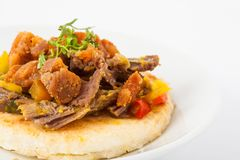 Colombian arepa topped with shredded beef and pork rind. Traditional Colombian arepa topped with shredded beef and pork rind Royalty Free Stock Photo