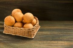 Buñuelos Colombian traditional food - Wood background royalty free stock images