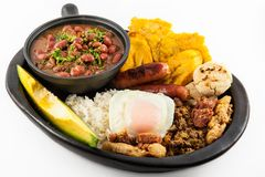 Traditional Colombian dish called Banda paisa. A plate typical of Medellin that includes meat, beans, egg and plantain royalty free stock photos
