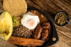Traditional Colombian food closeup. Typical colombian food from the Medellin area called Paisa Bandeja Stock Photos