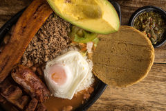 Traditional Colombian food. Closeup of typical colombian food from the Medellin area called Paisa Bandeja Stock Image
