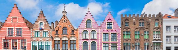 Houses at Market square in Bruges. Traditional colorful Belgian facades of houses at Market square in city of Bruges royalty free stock photos