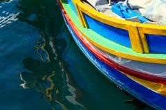 Traditional colorful boat luzzu at the port of Marsaxlokk, Malta. Copy space, closeup view. Traditional colorful boat luzzu detail at the port of Marsaxlokk royalty free stock photography