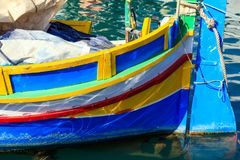 Traditional colorful boat luzzu at the port of Marsaxlokk, Malta. Closeup view. Traditional colorful boat luzzu detail at the port of Marsaxlokk, Malta. Closeup Royalty Free Stock Photos