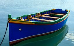 Traditional colorful boat luzzu at the port of Marsaxlokk, Malta. Closeup view. Traditional colorful boat luzzu with eye at the port of Marsaxlokk, Malta Stock Photography