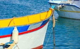 Traditional colorful boat luzzu at the port of Marsaxlokk, Malta. Closeup view. Traditional colorful boat luzzu detail at the port of Marsaxlokk, Malta. Closeup Stock Photography
