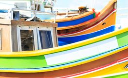 Traditional colorful boat luzzu at the port of Marsaxlokk, Malta. Copy space, closeup view. Traditional boat luzzu detail with bright colors at the port of royalty free stock photography
