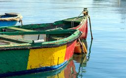 Traditional colorful boats luzzu at the port of Marsaxlokk, Malta. Copy space, closeup view. Traditional colorful boats luzzu detail at the port of Marsaxlokk stock images