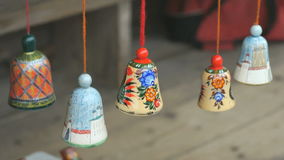 Traditional colorful festive wooden bells ringing stock footage