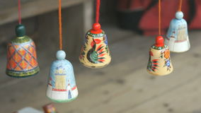 Traditional colorful festive wooden bells ringing stock video footage