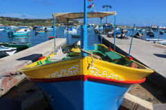 Traditional, colorful fishing boat in the harbor of Marsaxlokk,. A fisher village in the south of Malta Stock Photos