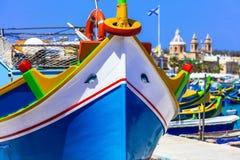 Traditional colorful fishing boats luzzu un Malta. Traditional colorful fishing boats luzzu in Malta - Marsaxlokk village Stock Images