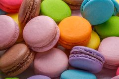 Traditional colorful french macarons are sweet meringue-based confection. Macro photography Stock Photography