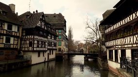 Traditional colorful houses in La Petite France, Strasbourg, Alsace, France. Medieval home facade, historic town. Beautiful archit stock video footage