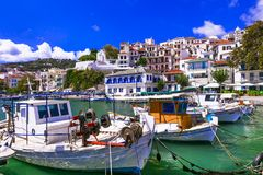 Traditional colorful Greece series - old port of Skopelos. Sporades islands. Traditional colorful houses,sea and boats in old port,Skopelos,Greece royalty free stock images