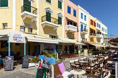 Traditional colorful houses and street cafes at street of Chani ton on Crete island, Greece Stock Photos
