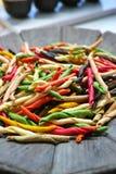 Traditional colorful Italian dried homemade pasta fusilli with e Stock Photos