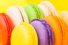 Traditional colorful macarons at yellow background Royalty Free Stock Image