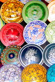 Traditional colorful Moroccan faience pottery dishes in a typical ancient shop in the Medina's souk of Marrakech, Morocco royalty free stock photos