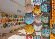 Traditional colorful Moroccan plates on the street walls of Marrakesh. Stock Photos