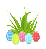 Traditional colorful ornamental eggs with grass for  Easter Stock Photography