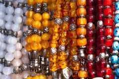 Traditional colorful rosaries Stock Photos