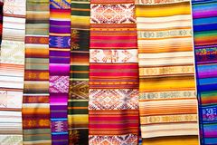 Traditional colorful textiles at Otavalo, Ecuador. Traditional woven blankets for sale in the market at Otavalo, Ecuador Royalty Free Stock Image