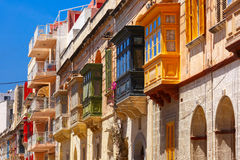 Traditional colorful wooden balconies, Malta. The traditional Maltese colorful wooden balconies in Sliema, Malta Royalty Free Stock Images