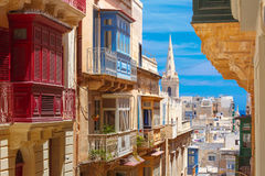 Traditional colorful wooden balconies, Malta Royalty Free Stock Image
